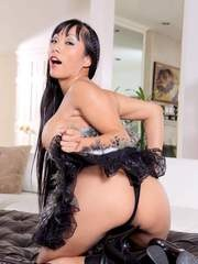 Asian pornstar Cindy Starfall unveils her big tits before showing her pussy