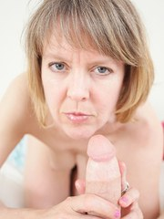 Older woman Jamie Foster strokes a cock from a POV perspective