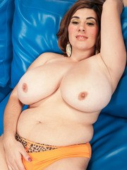 BBW solo model Elaina Gregory shows off her hooters while getting undressed