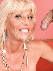 Older blonde lady Stormy Lynne releases her huge tits before sucking dick