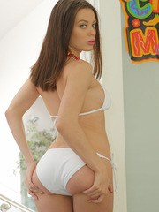 Young solo girl Lana Rhoades removes her white bikini to pose in the nude