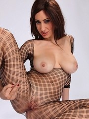 Brunette female Eloa Lombard releases her big natural tits from a bodystocking