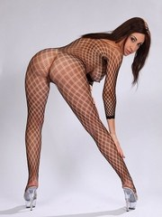 Solo girl Eloa Lombard works her way free and clear of a bodystocking