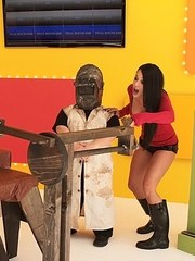 Nerdy brunette gets fucked by a sex machine for a fistful of cash