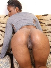 Leggy African female shows off the pink of her pussy and bare ass too