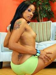 Black solo model Absolute Star holds her small tits as she partially strips