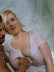 Curvy blonde chick with nice melons sucks on a big dick in the shower