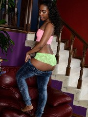 Ebony solo girl Chanell Heart peels off tube top and jeans to pose naked