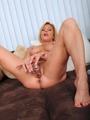 Older solo model Ginger Lynn removes lingerie before masturbating with a toy
