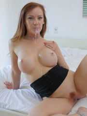 Busty redhead Dani Jensen hooks up with a large cock for a hardcore fuck