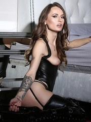 Fet model Natasha Starr struts in stiletto heeled boots with a crop