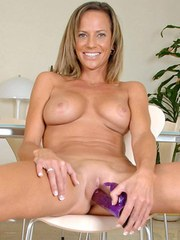 Horny older lady Montana Skye attacks her pussy with a freaky looking sex toy