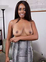 Ebony girl Amber Cream poses nude while trying on different pairs of underwear