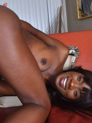 Ebony beauty pulls down her panties to finish getting naked for nude poses
