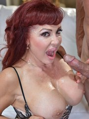 Mature redhead Sexy Vanessa sucks the jizz out of a cock in her lingerie