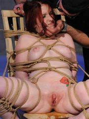 Rope bound female is not happy after being used against her will