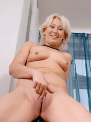 Older lady removes her clothing prior to satisfying her pussy with a vibrator