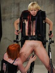 Restrained blonde female is tortured until she loses control of her bladder