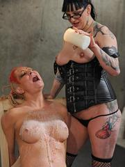 Redhead alt girl screams as hot wax is poured over her exposed breasts