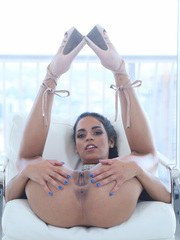 Latina solo model Vienna Black strips to high heels with the blinds open