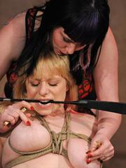 Clothed lesbian subjects her female lover to tit torture and bare ass spanking