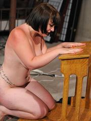 Fat brunette chick is made to masturbate by latex clad lesbian