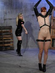 Submissive redhead is tortured and masturbated by a blonde female