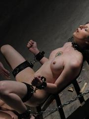 Restrained female is tortured and masturbated by her lover during lezdom play