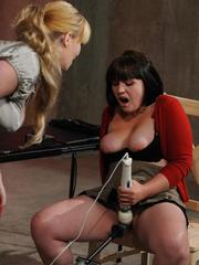 Blonde female fucks a dyke with a machine cock and brings her to orgasm too