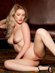 Nude model Ora Young strikes sexy solo poses for centerfold spread