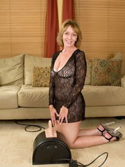 Older woman Samantha Stone parks her horny cunt atop a Sybian sex machine