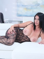 Curvy Latina chick Cristal Caraballo releases her big tits from bodystocking