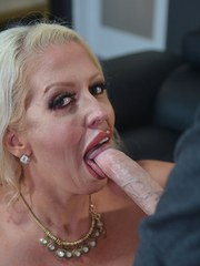 Top pornstar Alura Jenson holds her knockers while giving a blowjob