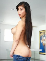 Young Asian girl Jade Kush exposes her nice melons as she undresses