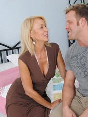 Hot mature woman Erica Lauren seduces a younger boy for sexual relations