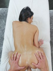 Big boobed MILF Veronica Rayne is slathered in oil before sex with her masseur