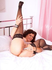 Nature woman in black nylons pulls out a vibrator to masturbate with