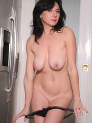Dark haired middle-aged lady Karen Kougar undresses and toys her horny snatch
