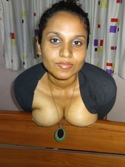 Fat Indian chick flaunts her big boobs during a live webcam show