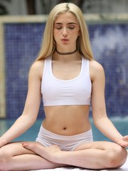 Blonde teen Jane Wilde takes a shower after yoga and meditation session
