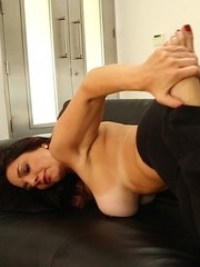 Older Latina lady Mindi Mink sucks her own toes before baring her big boobs