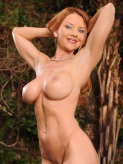 Hot mature lady Janet Mason bares her large boobs before toying her snatch