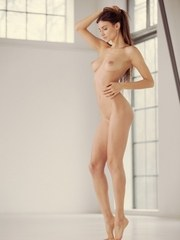 Leggy ballerina Ilvy Kokomo uncovers her nice tits as she poses in the nude