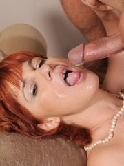 Older redhead in fishnet stockings and high heels seduces her lover
