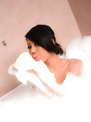 Sexy Asian teen tranny Army takes bubble bath and plays with big tits