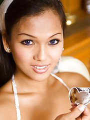 Horny Thai tranny Amy sucking on an ice cream and spreading her legs