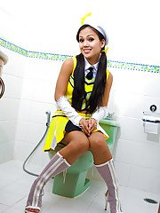Cute Thai shemale Amy posing and getting nasty in a bathroom