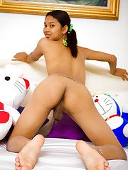 Tight teen Asian shemale Lee spreading her nasty asshole on her bed