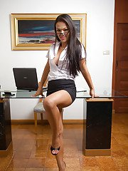 Busty Thai shemale Amy getting her hairy dick hard in the office