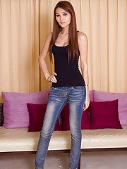 Young Asian shemale Paris strips off denim jeans for teen cock jerking